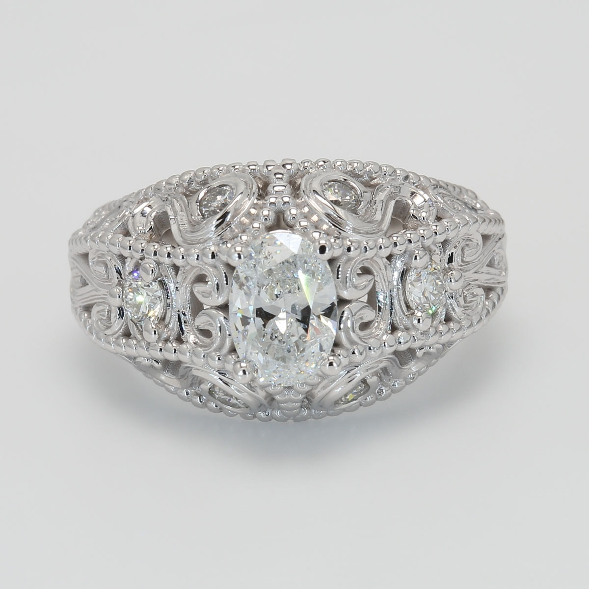 Ornate Semi Mount Oval Diamond Engagement Ring