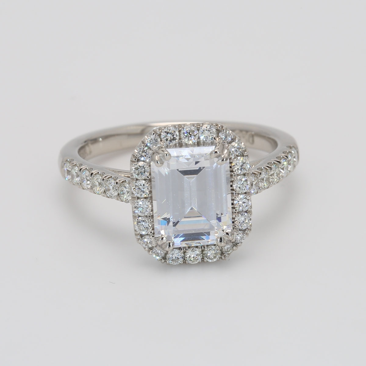 Custom GIA Emerald Cut Halo Engagement Ring in Platinum