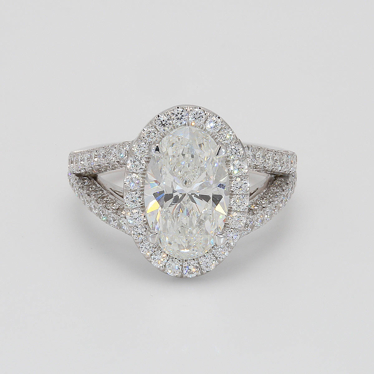 Gia 3.01Ct Oval 1.17Ct Halo Split Shank 18KW 7.3 Grams