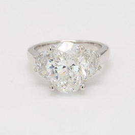 4 CT Oval wtih 1.05D Half Moon Three Stone Ring