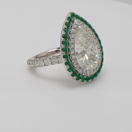 8.80 CT Pear Shaped Diamond Ring with Emerald Halo