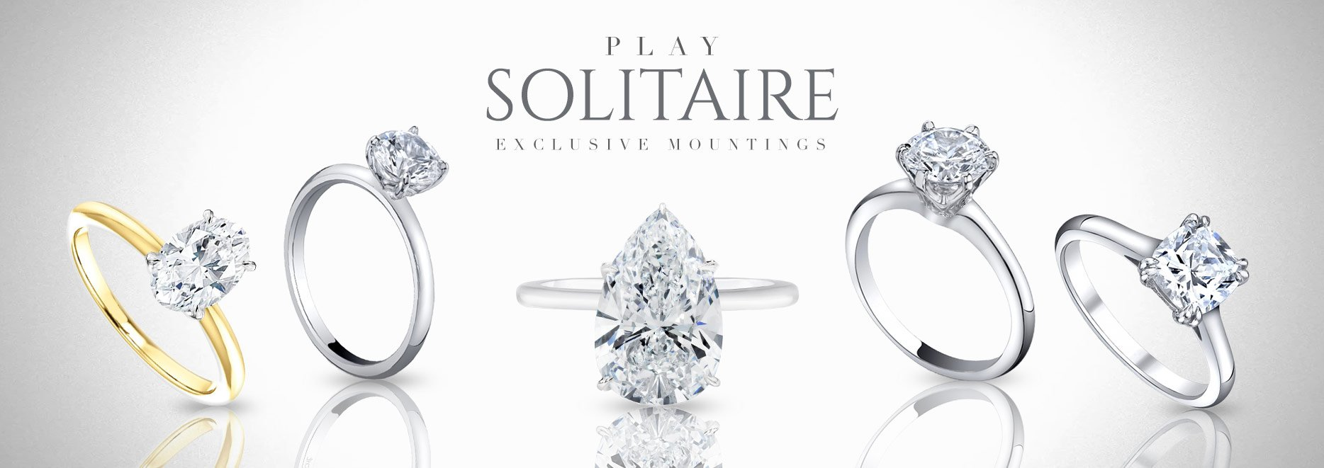 group of diamond white and yellow gold solitaire rings