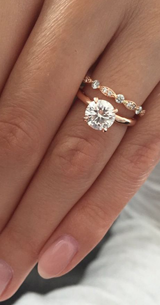 round diamond engagement ring on woman's hand