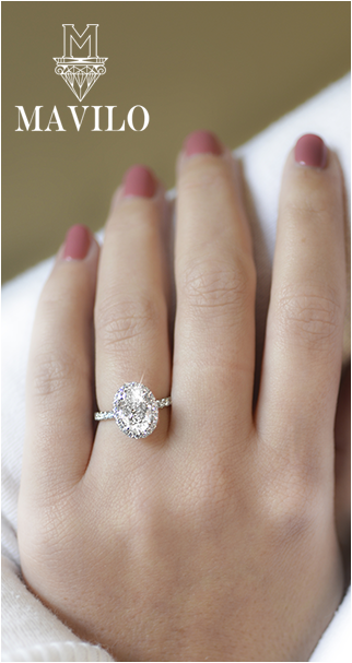 oval diamond engagement ring on resting womans hand